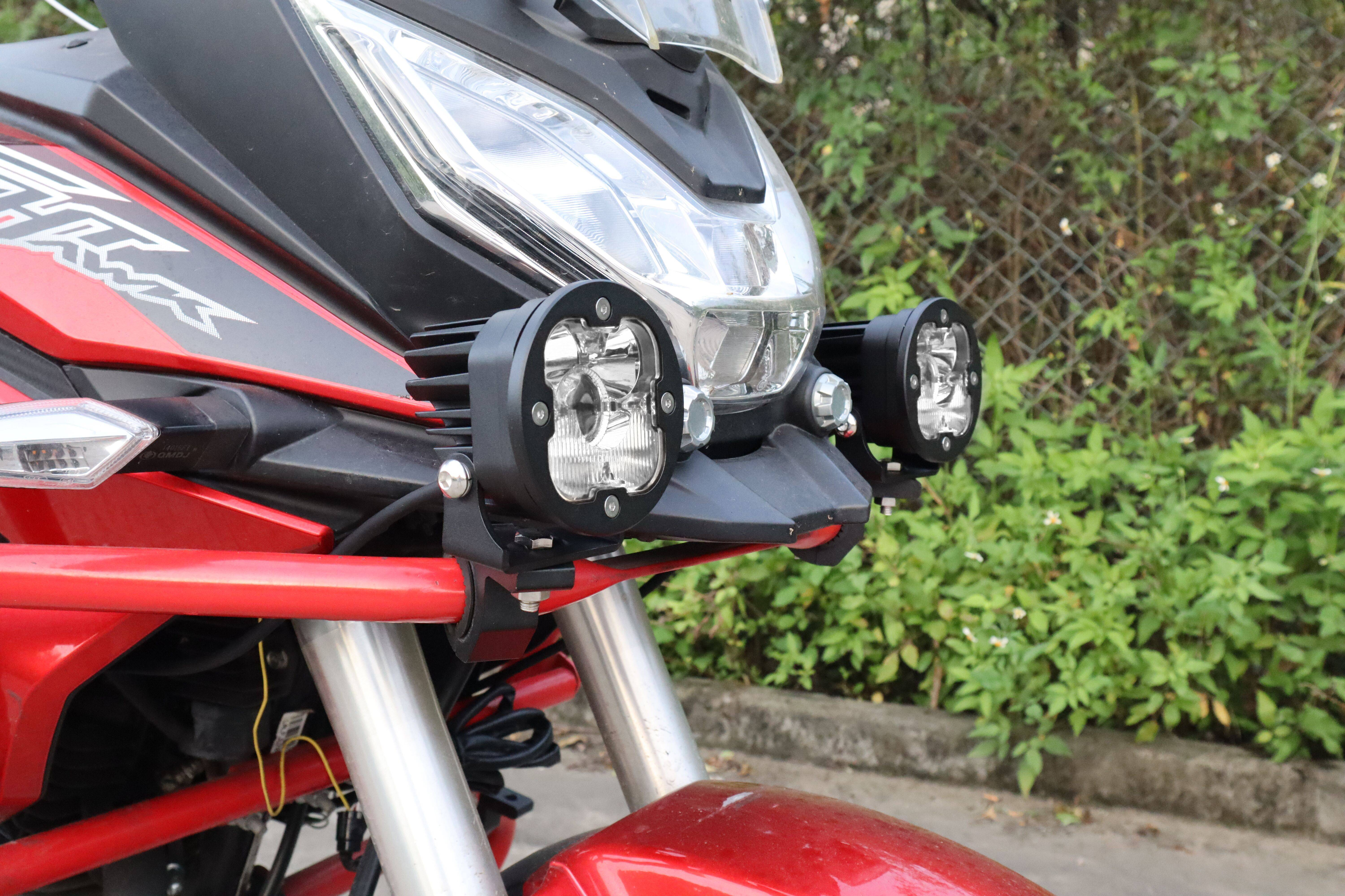 off road laser driving lights on motorcycle
